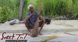 Elderly Cocoyea broom man in Aranguez on side of road barefooted, white hair, striped shirt, brown short pants, bony legs, in Sweet T&T, Sweet TnT Magazine, Trinidad and Tobago, Trini, vacation, travel