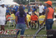 Children play musical chairs at family day by Marika Mohammed, orange, yellow, purple, blue, white t shirts, teams, denim blue jeans, savannah, man on microphone, tents, in Sweet T&T, Sweet TnT, Trinidad and Tobago, Trini, vacation, travel
