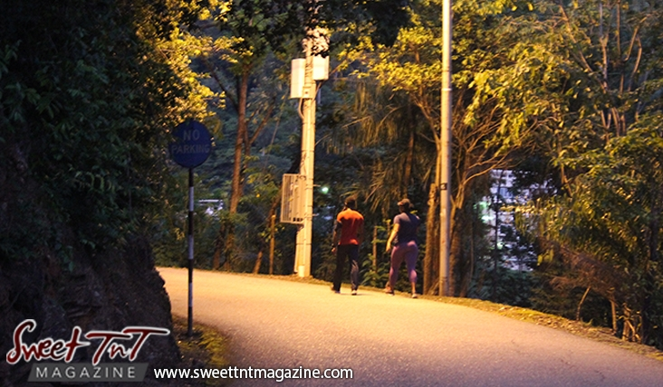 Couple walking exercising on Lady Chancellor Hill Port of Spain for story original outdoor gym in Sweet T&T, Sweet TnT, Trinidad and Tobago, Trini, vacation, travel