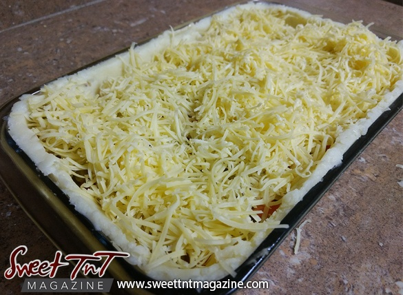 Potato crust quiche, grated cheese in sweet T&T for Sweet TnT Magazine, Culturama Publishing Company, for news in Trinidad, in Port of Spain, Trinidad and Tobago, with positive how to photography.