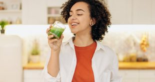 Top 10 Vitamins for Beauty, woman in white blazer drinking a fresh smoothie